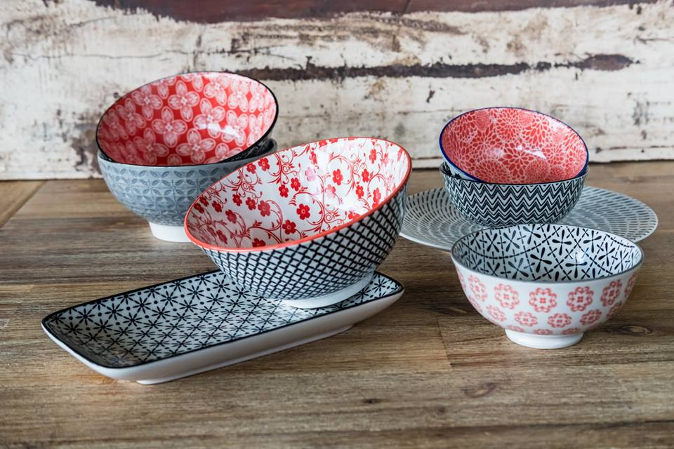 small bowls and plates with red and blue patterns