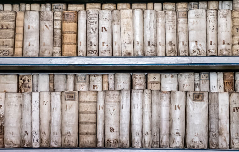 row of old tattered white books