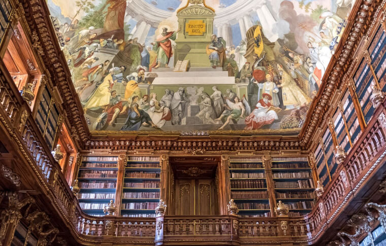 old library with wooden shelves and painted ceiling