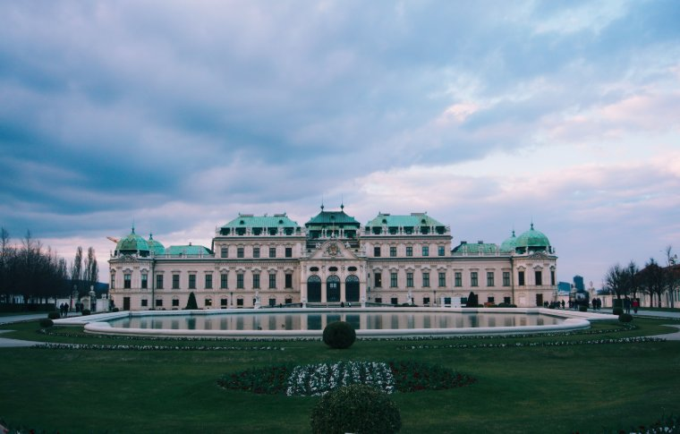 Belvedere Palace with a fountain and gardens in front.