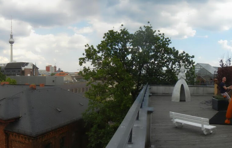 A rooftop gallery with sculptures.