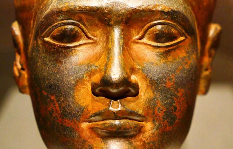 up close shot of egyptian golden statue face