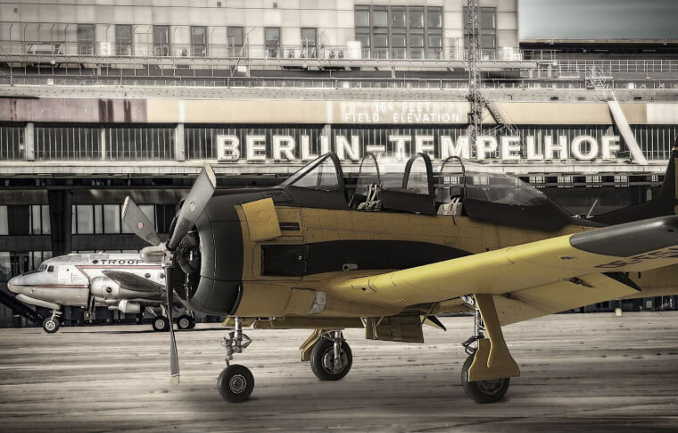 small old yellow propeller plane
