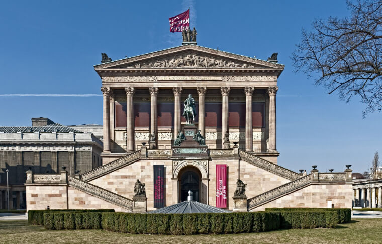 large museum with symmetrical stairs and columns at entrance