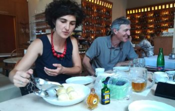 woman and man eating in restaurant
