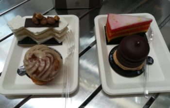 two plates of various cakes