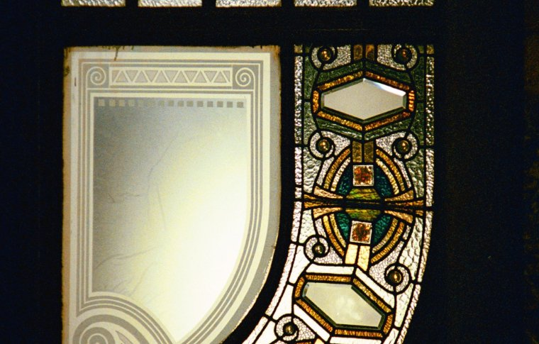Intricate designs on a stained glass window.