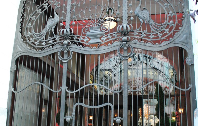 A beautiful ornate gate entrance to the building