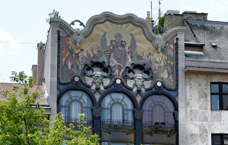 A religious mural above an ornate window