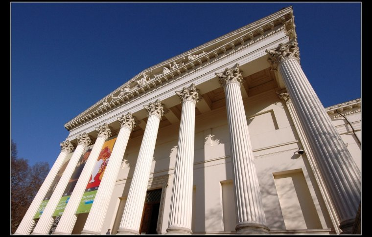 entrance to white building with large columns