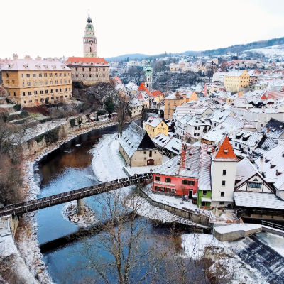 aerial view of town covered in snow with river running through
