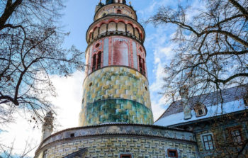 looming cylindrical tower with pinks and greens