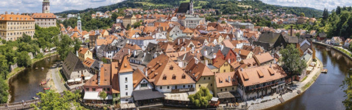 overview of medieval town with red roofs and white walls