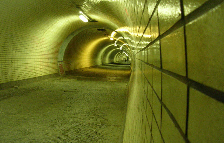 circle green tunnel with shiny tiles