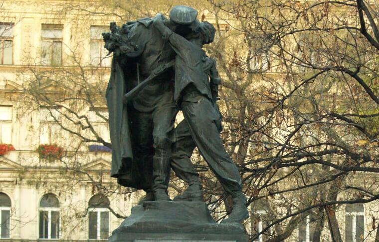 metal sculpture of two men embracing
