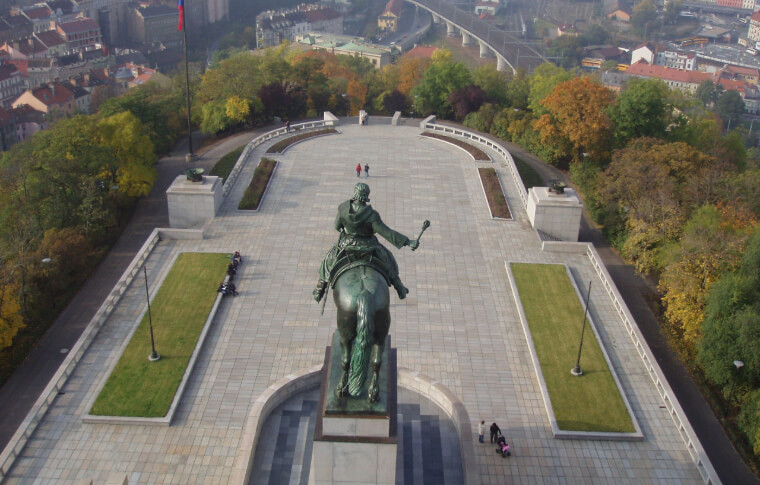 aerial view of sculpture of man on horse overlooking square in a park