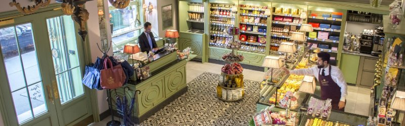 Sweet shop with one man working at it in Vienna