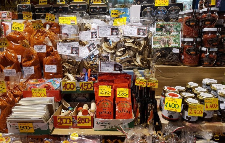 various food items on shop shelf with pricing