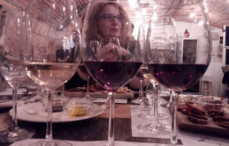 woman posing through various wine glasses