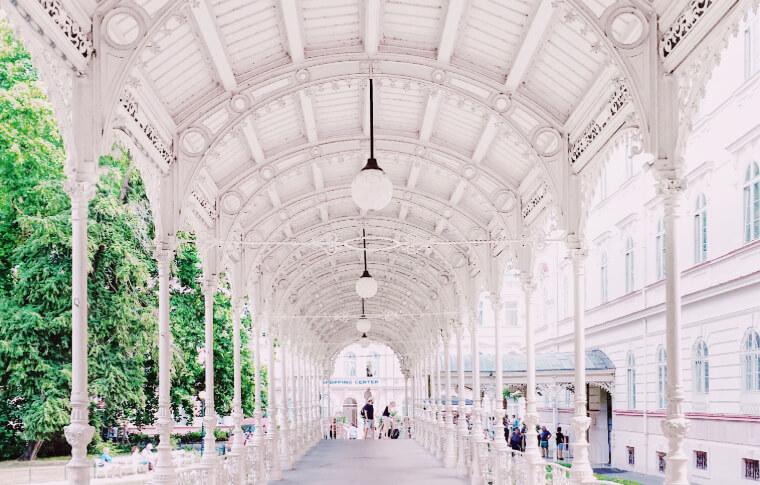 serene outdoor walkway leading to gazebo in all white