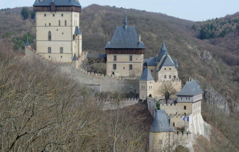 castle built on hillside with grey roof tiles