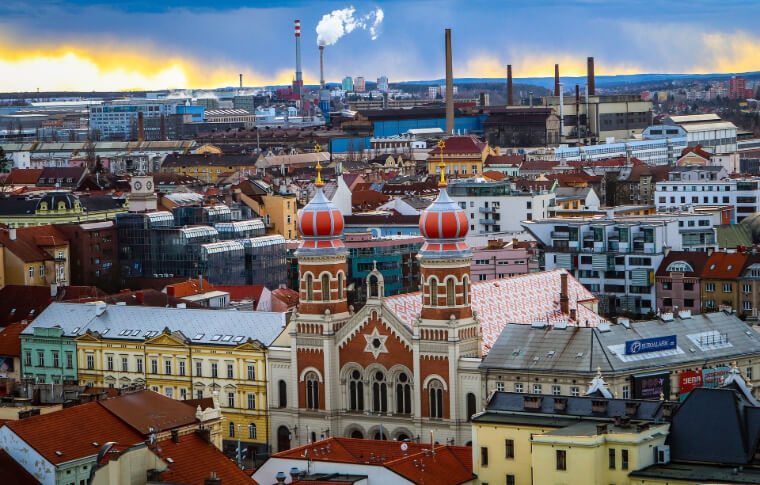 aerial view of town with large red brick synagogue in foreground