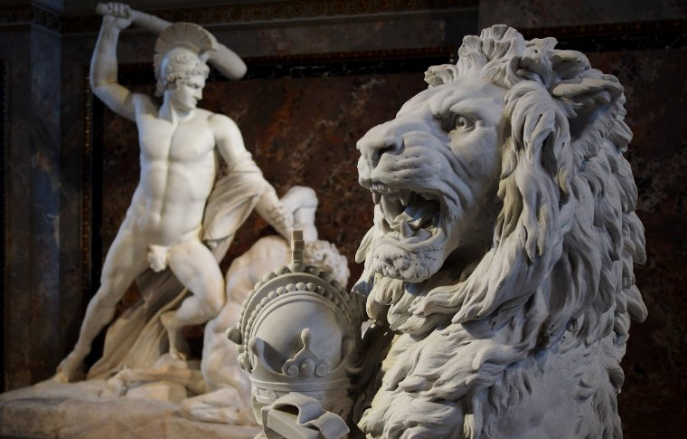 stone sculpture of man with large lion head