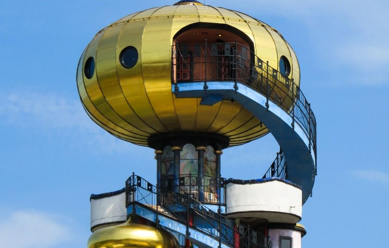 large golden spherical tower