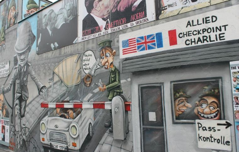 wall in Berlin with various flags displayed