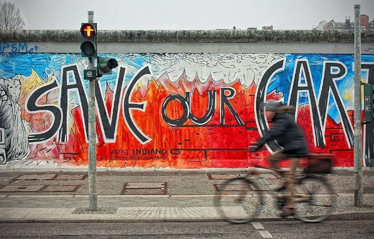 a bike in motion infront of Berlin street art