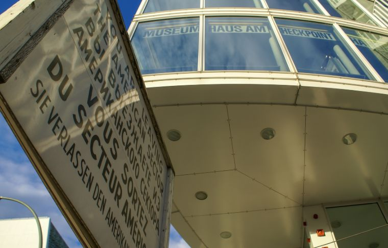 Sign and building seen from below