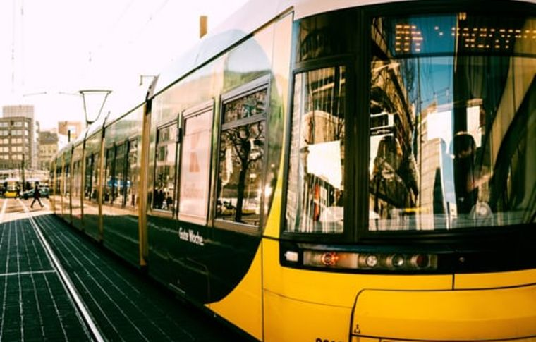 yellow bus in Berlin with refelction in front window