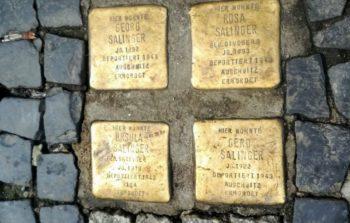 Stolpersteine memorials engraved in between the street cobbles.