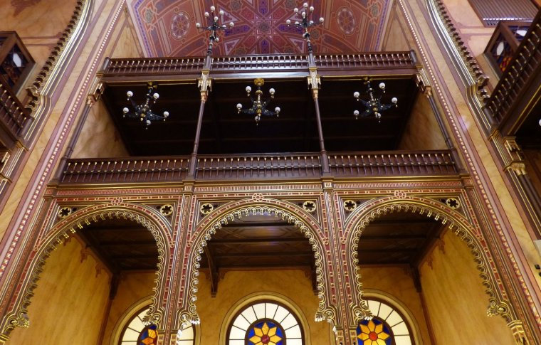 Stained glass windows and ornate arches at the Dohány Street Synagogue.
