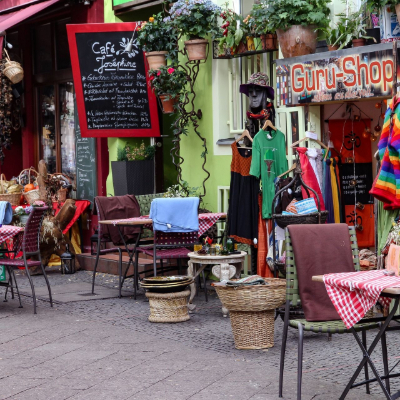 Colorful street in Kreuzberg with a shop and a cafe