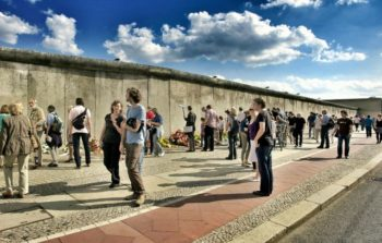 Tourists look at remains of the Berlin Wall.