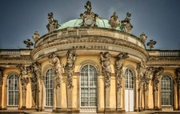 ornate palace with gargoyles and arch windows