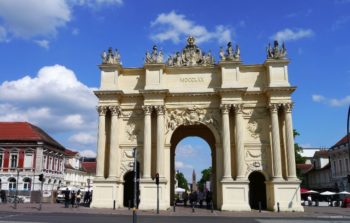 military memorial gate with statues on top