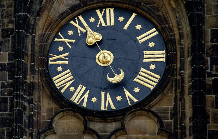 black and gold clock face