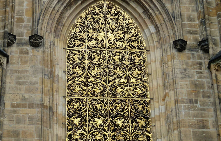 intricate gold metal work on church or castle entrance