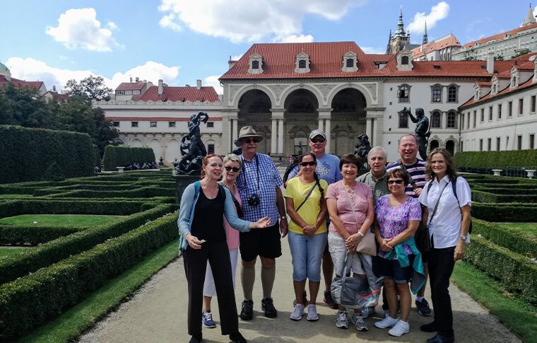 group of people smiling on a tour to Prague's 4 gardens