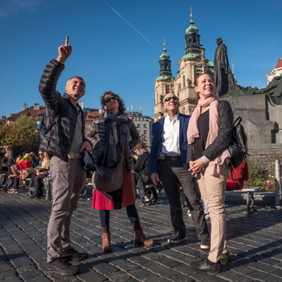 tour guides pointing at object behind camera and smiling
