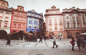 old square with various buildings of pink red and blue