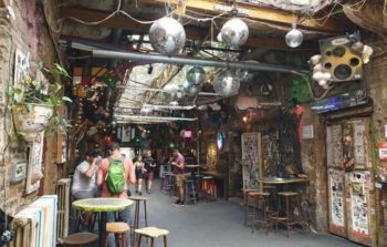 Disco balls hang from the roof of a ruin bar.