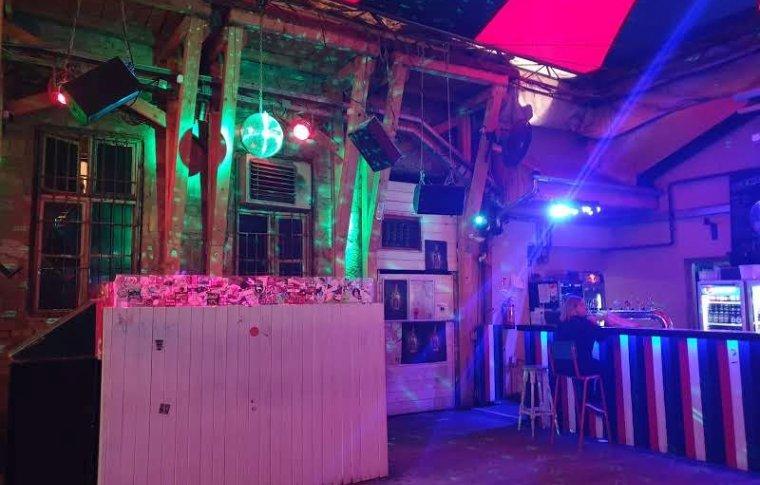 Neon lights light up the ruin bars at night.