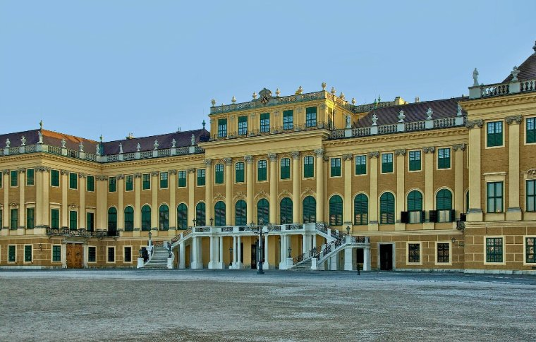 large palace with yellow walls and many windows