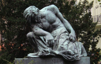 statue of shirtless man looking down