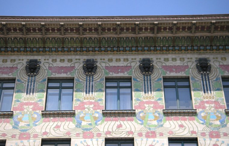 Pastel colored drawings on a building.