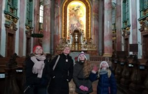 Family on a walking tour in a church in Vienna