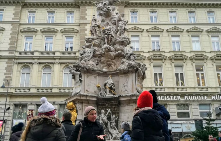 walking tour in front of a water fountain in Vienna